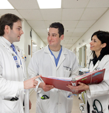 Three cardiology residents reviewing a patient chart at Tufts Medical Center in Boston.